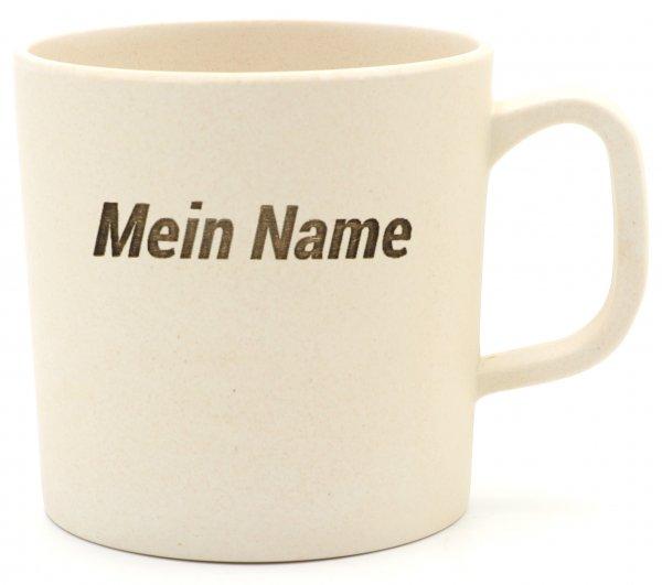 DEIN NAME auf einem Kaffeebecher